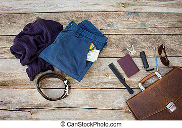 Men accessories and clothing on wooden background. Top view.