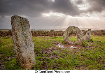 The Men-an-Tol is thought to date to either the late Neolithic or early Bronze Age. Located on Penwith Moor Cornwall England these standing stones are steeped in myth and legend.