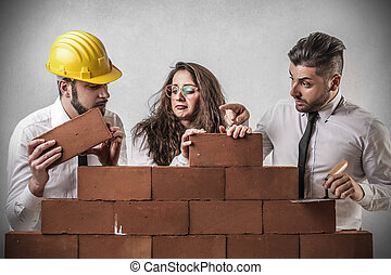 Men and woman with wall