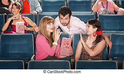 Men and Women Flirting in Theater