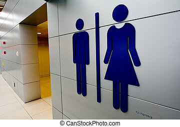 Men and women toilet signs. - Men and women toilet signs on...