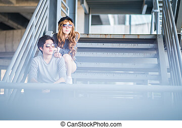 Men and women wearing sunglasses Standing on a steel frame construction