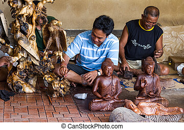 Men are making wooden crafts in Indonesia
