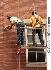 Men at work 03 - 2 men at work on scaffold with safety...
