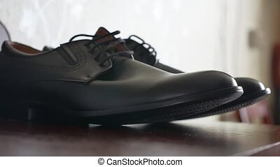 Men black shoes stand on the table. Morning businessman -...