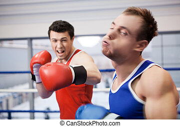 Men boxing. Two boxers fighting on the boxing ring