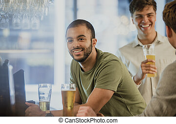 Men Buying Drinks At The Bar