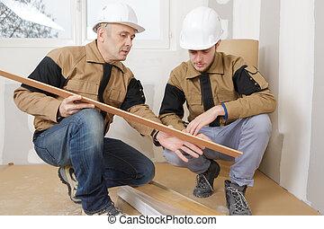 men carpenter choosing wood