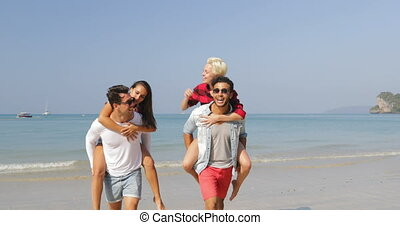 Men Carry Women On Back, Two Couples Running On Beach Happy...