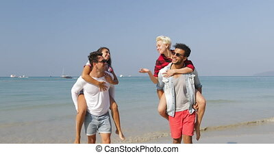 Men Carry Women On Back, Two Couples Walking On Beach Happy Cheerful People Talking Tourists On Vacation