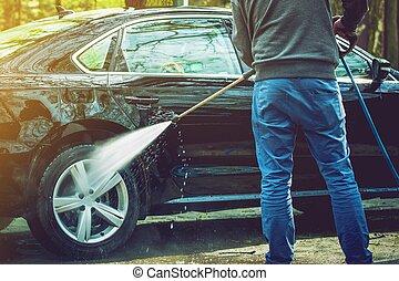 Men Cleaning His Modern Car
