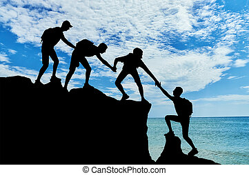 Conceptual scene of male mountaineers work in a team