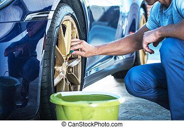 Men Detailing His Exotic Car Alloy Wheels