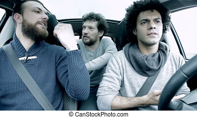 Three men discussing and fighting driving car