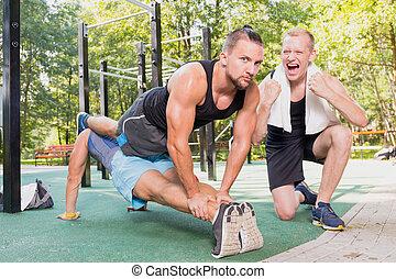 Men doing plank exercise