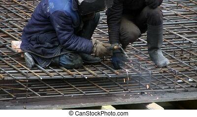Men doing welding on site