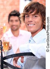 Men drinking champagne