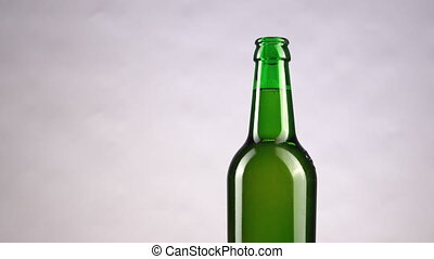 Men drinking cold bottle of beer background. Hands lifting refrigerated wheat or lager beer out of the frame