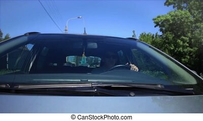 men driving a car in motion view of