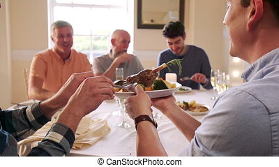 Men Eating At A Dinner Party - Men are eating at a dinner...