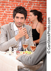 Men eating in a restaurant