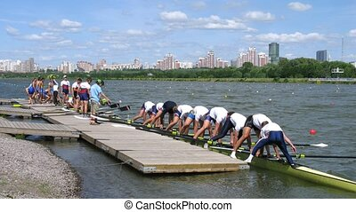 Men eights teams take off from pier during Big Moscow regatta