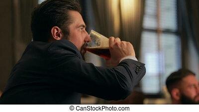 Men Enjoying Drinks - Men are enjoying pints in a bar...