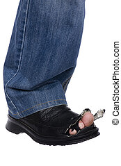men feet in blue jeans and boots