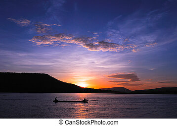 Men fishing on the Mekong River in a field at sunset