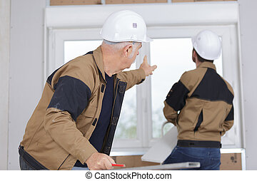 Men fitting new pvc window