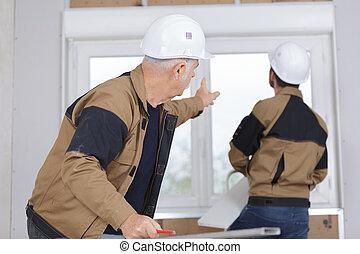 Men fitting new pvc window