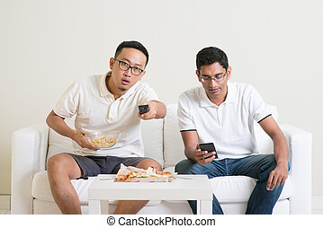 Men friends watching sport game on tv together