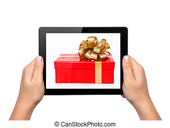 Men hands hold a tablet touch computer gadget with a gift