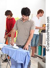 Men housemates doing daily chores