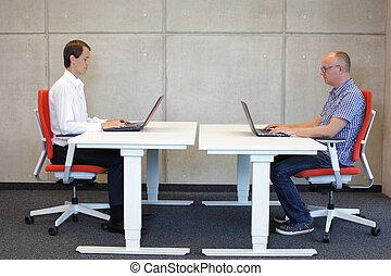 men in correct sitting posture