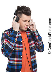 Men in headphones. Cheerful young men listening to the music while standing isolated on white