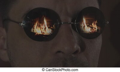 men in sunglasses, looking at the fire