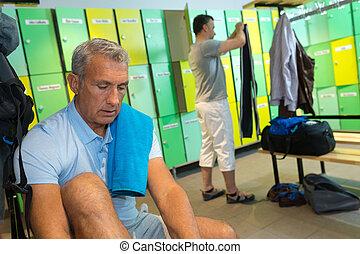 men in the gym locker room