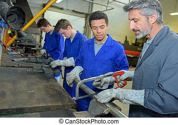 men in the steel factory