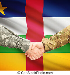 Men in uniform shaking hands with flag on background - Central African Republic
