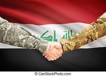 Men in uniform shaking hands with flag on background - Iraq