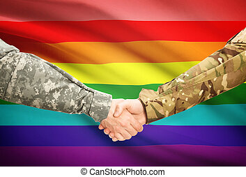 Men in uniform shaking hands with flag on background - LGBT people