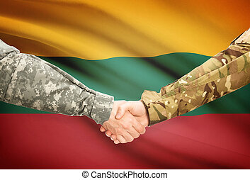 Men in uniform shaking hands with flag on background - Lithuania