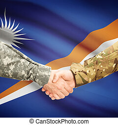 Men in uniform shaking hands with flag on background - Marshall Islands