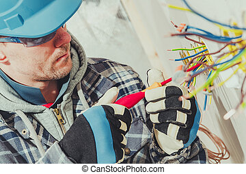 Men Installing Row of Power Outlets Inside Newly Developed House