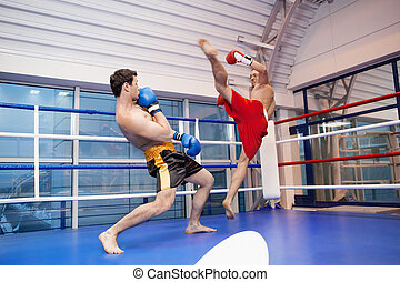 Men kickboxing. Two young men kickboxing on the ring