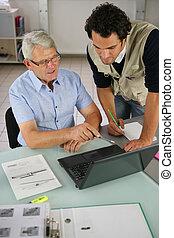 Men looking at a laptop computer