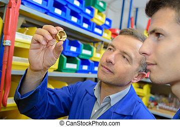men looking at a socket
