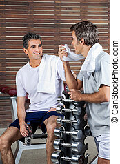 Men Looking At Each Other After Work Out - Happy men looking...