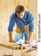 men looks on the blueprint